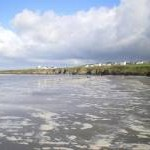 Retreating tide on Poppit Sands