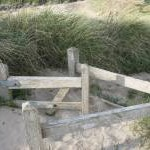 A disappearing kissing gate at Porth Trecastell
