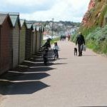 South West Coast Path and beach huts at Budleigh Salterton sea front