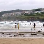 Evening surfers at high water, Polzeath