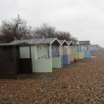 Pastel coloured beach huts on Broadmark Beach