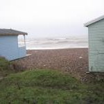 Looking between the beach huts on Broadmark Beach