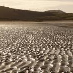 Llanmadoc: ripply section of beach at Broughton Bay
