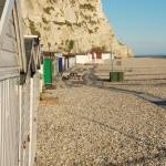 Beer: Beach huts under the cliff