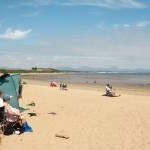 Blue skies and miles of golden sands at Llanbedrog