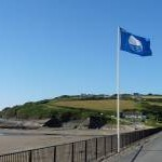 Blue flag and a blue sky, Broad Haven