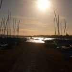 Mudeford: the sun among yacht masts