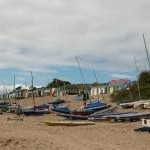 Boats and chalets at Borth Fawr Beach, Abersoch