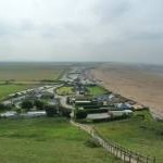 Brean Down beach, cafe, car park and Tropical Bird Centre from steps