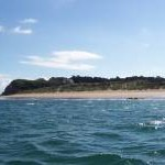 View of beach on Caldey Island from boat