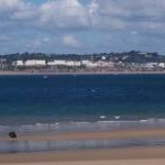 View across to Tenby from beach on Caldey Island