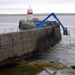 Reinforcing the harbour wall, Castletown