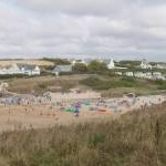 Treyarnon beach with bathers' windbreaks