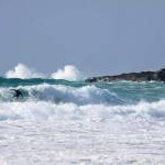 Surfing in Fistral Bay