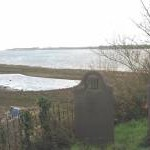 A coastal lagoon below Llanfair-is-gaer graveyard