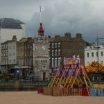 Margate: beach amusements and clock tower