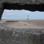 Talacre: the lighthouse through a concrete slot
