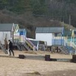 Battered beach huts at Wells-next-The-Sea