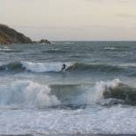 Surfing at Challaborough Bay