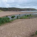 Stream crosses the beach at Freshwater East
