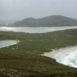 View across the southern part of Vatersay from Heiseabhal Mor in deteriorating weather