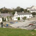 Houses huddled round the Porth Moelfre cove
