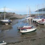 Looking past the beached boats out into Porlock Bay