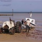 Bringing the boat in at Overstrand beach